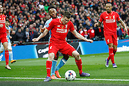 James Milner of Liverpool lets the ball go out under pressure from Raheem Sterling of Manchester City.  Capital One Cup Final, Liverpool v Manchester City at Wembley stadium in London, England on Sunday 28th Feb 2016. pic by Chris Stading, Andrew Orchard sports photography.