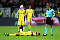 Chelsea's Olivier Giroud lies on the pitch after being tackled during the UEFA Europa League Semi final, first leg match at The Frankfurt Stadion, Frankfurt.