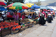 Food market and traders selling their wares and goods on display, street scene, San Cristobal de las Casas, Chiapas, Mexico.