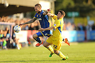 Adam Buxton of Accrington Stanley intercepts Sean Rigg of AFC Wimbledon (l). Skybet football league two play off semi final, 1st leg match, AFC Wimbledon v Accrington Stanley at the Cherry Red Records Stadium in Kingston upon Thames, Surrey on Saturday 14th May 2016.<br /> pic by John Patrick Fletcher, Andrew Orchard sports photography.