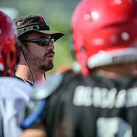081715  Adron Gardner/Independent<br /> <br /> Varsity football coach Rio Thompson  speaks to players during practice at Grants High School Monday.