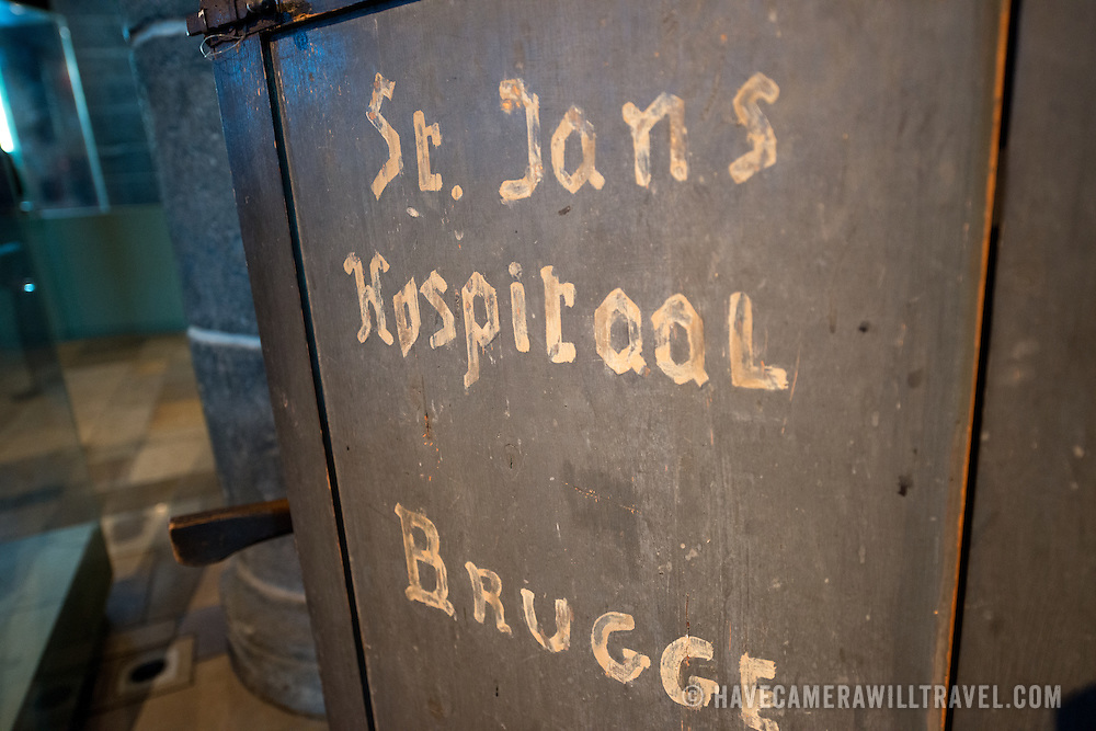 An original ambulence on display at Old St. John's Hospital in Bruges, Belgium. Old St. John's Hospital is one of Europe's oldest surviving hospital buildings that dates to the 11th century. It originally treated sick pilgrims and travelers. A monastery and convent was later added. It is now a museum.