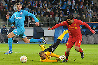 Thu., Feb. 14, 2013, Russia, St. Petersburg. .Liverpool's Luis Suarez, right, against  Zenit St. Petersburg's goalkeeper Vyacheslav Malafeyev, center, and Nicolas Lombaerts, left, in the UEFA Europa League's last 32 match..Kommersant Photo/Alexander Petrosyan