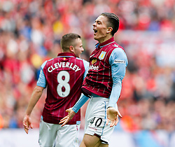 Jack Grealish of Aston Villa celebrates after Fabian Delph scores a goal to make it 2-1 - Photo mandatory by-line: Rogan Thomson/JMP - 07966 386802 - 19/04/2015 - SPORT - FOOTBALL - London, England - Wembley Stadium - Aston Villa v Liverpool - FA Cup Semi Final.