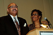 Andrew Lyke of the Office for Black Catholics emcees the Gala Benefit Fundraiser for the Cause for Sainthood of Father Augustus Tolton with his wife Terri at Hyatt Regency McCormick Place in Chicago.  Tolton was a slave born in Missouri in 1854 before joining the Catholic Priesthood. The movement for his sainthood was begun in February, 2011 with the assistance of Chicago Archbishop Francis Cardinal George and Bishop Joseph Perry. November 11, 2011 l Brian J. Morowczynski~ViaPhotos..For use in a single edition of Catholic New World Publications, Archdiocese of Chicago. Further use and/or distribution may be negotiated separately. ..Contact ViaPhotos at 708-602-0449 or email brian@viaphotos.com.