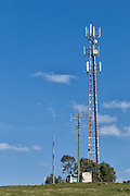 Rural cellular, microwave and communications antenna array for the mobile telephone system on a triangular lattice tower and equipment enclosure shelter in country New South Wales, Australia. <br /> <br /> Editions:- Open Edition Print / Stock Image