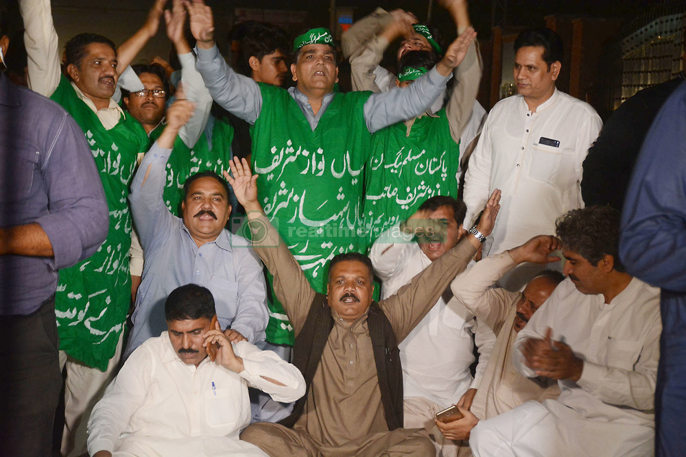 """October 5, 2018 - Lahore, Punjab, Pakistan - Pakistan supporters of opposition leader Shahbaz Sharif chant slogans outside the office of National Accountability Bureau(NAB) following the opposition leader Shahbaz Sharif arrest, in Lahore on October 05, 2018. Pakistan's anti-graft body announced that it had arrested the country's opposition leader"""" former Chief Minister Punjab and Pakistan Muslim League-Nawaz (PML-N) President Shahbaz Sharif, over his alleged links to a multi-million dollar Ashiana Housing Scheme. officials said, the latest corruption allegation against the Sharif political dynasty that was ousted from power by ex-cricketer Imran Khan in elections this summer. (Credit Image: © Rana Sajid Hussain/Pacific Press via ZUMA Wire)"""