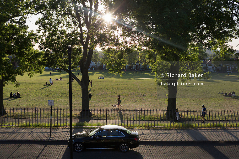 As the number of UK deaths from Coronavirus reaches 37,837, a further 377 in the last 24hrs) Londoners enjoy the last moments of a summer evening in Ruskin Park, A south London green space, during the UK Coronavirus pandemic lockdown, on 28th May 2020 in London, England.