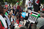 A man dressed as Charlie Chaplin shows his support for Gaza.<br /> <br /> Tens of thousands of protesters marched in Central London to show their outrage against the Israeli onslaught on Gaza.