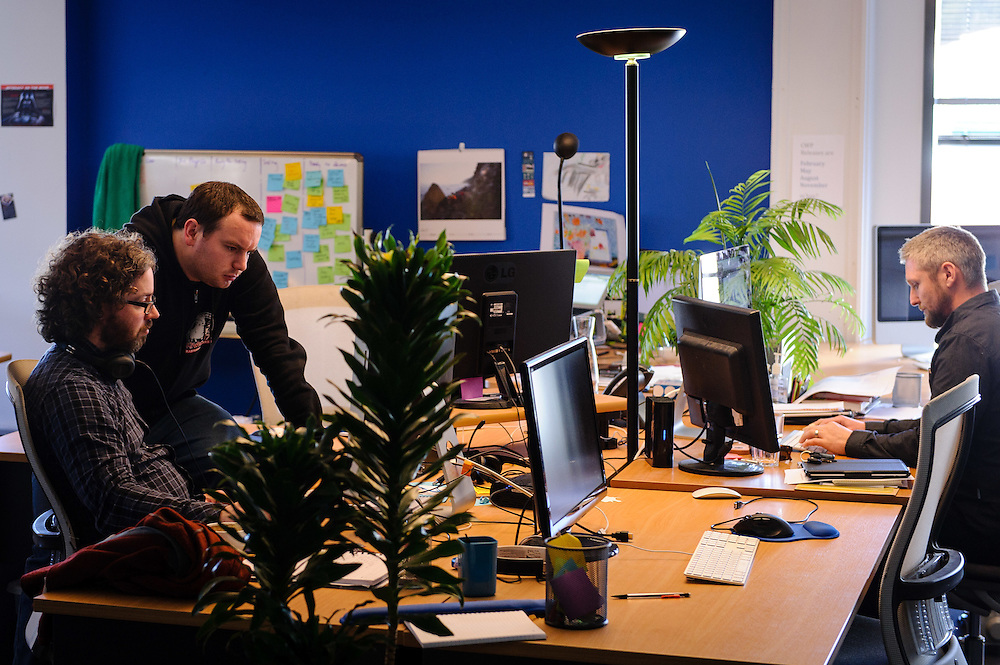 Staff at work in the Silverstripe offices. WELLINGTON, NEW ZEALAND - August 05:  Silverstripe profile: Tuesday 5 August 2014. August 05, 2014 in Wellington, New Zealand.  Silverstripe Business Profile.  (Photo by Mark Tantrum/ mark tantrum.com)