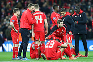 Liverpool players looking dejected after the end of the match. Capital One Cup Final, Liverpool v Manchester City at Wembley stadium in London, England on Sunday 28th Feb 2016. pic by Chris Stading, Andrew Orchard sports photography.