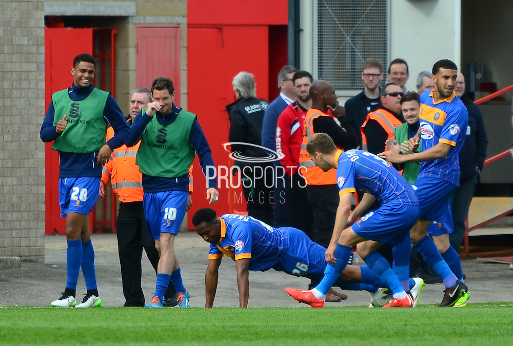 Jean-Louis Akpa Akpro celebrates with team mates after scoring the first goal during the Sky Bet League 2 match between Cheltenham Town and Shrewsbury Town at Whaddon Road, Cheltenham, England on 25 April 2015. Photo by Alan Franklin.
