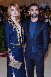 Emma Stone and Nicolas Ghesquiere walking the red carpet at The Metropolitan Museum of Art Costume Institute Benefit celebrating the opening of Heavenly Bodies : Fashion and the Catholic Imagination held at The Metropolitan Museum of Art  in New York, NY, on May 7, 2018. (Photo by Anthony Behar/Sipa USA)