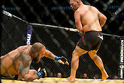 LAS VEGAS, NV - JULY 9:  Cain Velasquez knocks down Travis Browne during UFC 200 at T-Mobile Arena on July 9, 2016 in Las Vegas, Nevada. (Photo by Cooper Neill/Zuffa LLC/Zuffa LLC via Getty Images) *** Local Caption *** Cain Velasquez