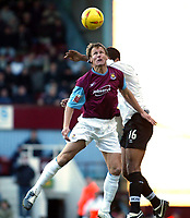 Photo. Chris Ratcliffe, Digitalsport<br /> West Ham United v Derby County. Coca Cola Championship. 23/01/2005<br /> Teddy Sheringham of West Ham goes up for this aerial ball with Tom Huddlestone of Derby