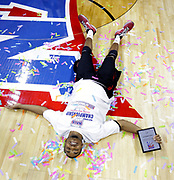 Mid-America Christian's Nick Tate lays on a confetti-covered court as he celebrates his team's 100-99 overtime win over Georgetown (Ky.) at the end of the NAIA championship basketball game in Kansas City, Mo., Tuesday, March 22, 2016. (AP Photo/Colin E. Braley)