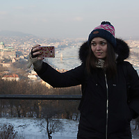 Woman takes a selfie with ice blocks floating on river Danube in the background in Budapest, Hungary on January 10, 2017. ATTILA VOLGYI