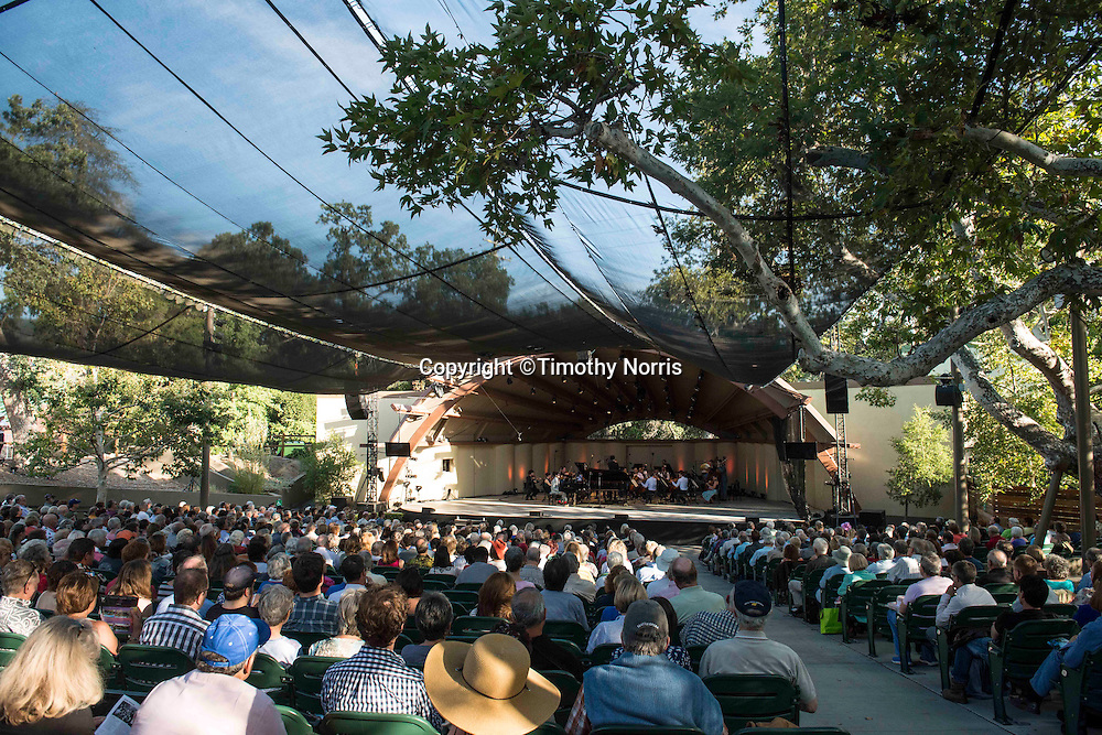 """Timo Andres (piano) and The Knights, conducted by Eric Jacobsen, perform Mozart's """"Coronation"""" concerto, re-composed by Timo Andres at the 68th Ojai Music Festival at Libbey Bowl on June 14, 2014 in Ojai, California."""