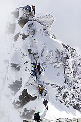 THEMENBILD - Bergsteiger mehrer Seilschaften bei der Glocknerscharte und am Kleinglockner. Das Glocknerschartl ist das Nadelöhr am Normalweg, wo sich immer wieder ein Stau bilden kann. Der Großglockner ist mit 3798 m ü.A. der höchste Berg Österreichs und ein beliebtes Ziel zahlreicher Bergsteiger. Er ist in der Glocknergruppe in den Hohen Tauern. Aufgenommen am 11.10.2014 in Tirol, Österreich // Mountaineers on Kleinglockner and Glockner Notch. Grossglockner is the highest mountain of austria and is located in the Hohe Tauern mountain range which is part of the  central eastern alps. Tyrol, Austria on 2014/10/11. EXPA Pictures © 2014, PhotoCredit: EXPA/ Michael Gruber