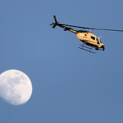 The Orange County Sheriff''s helicopter is seen at sunset as officers search for suspect Markeith Loyd at the Tzadik Brookside Apartments on January 9 2017 in Orlando, Florida. Loyd shot an Orlando Police officer earlier in the day at a local Walmart, the officer has since died.  (Alex Menendez via AP)