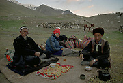 """At our camp spot at Sang Nevishta (""""written on the rock"""" in Persian), we meet Rani Boi (L) and his son, returning from a funeral in Ishkashim (a 15 days round trip from their settlement near the Chinese border) whom we had met 2 years earlier in Pakistan. Dinner is black tea and """"bortsok"""", some kind of fried dough... the Kyrgyz diet has officialy started!<br /> <br /> Adventure through the Afghan Pamir mountains, among the Afghan Kyrgyz and into Pakistan's Karakoram mountains. July/August 2005. Afghanistan / Pakistan."""
