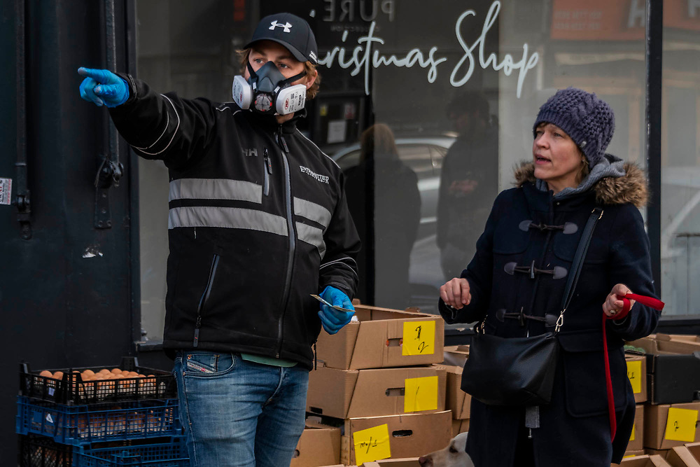 Staff are protected with masks as a business reacts to the loss of its client base by selling fresh stocks direct to the public on Northcote Road, Battersea. Prices for eggs are similar to supermarkets and the price for two veg boxes includes milk and juice - Entremettier, a fruit and veg wholesaler who operate from New Covent Garden Market and normally supply hotels, restaurants, clubs and directors dining rooms in London, the Home Counties and the South East (www.entremettier.co.uk) - Anti Coronavirus (Covid 19) outbreak in London.