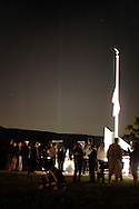 Washingtonville, N.Y. - Beams from the Tribute in Light in Manhattan are visible in the background at the Washingtonville 5 Firefighters World Trade Center Memorial after a memorial service on Sept. 11, 2006. The Memorial was built in honor of five FDNY firefighters from Washingtonville and the many others who lost their lives on September 11, 2001 in the World Trade Center terrorist attack.