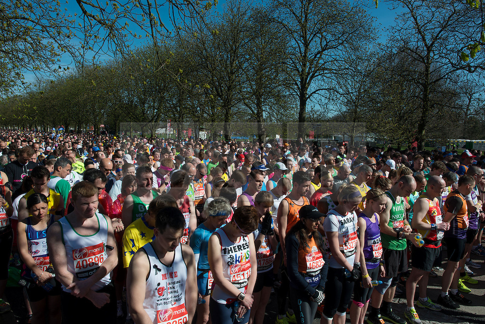 © Licensed to London News Pictures. 21/04/2013. London, UK. Runners observe 30 seconds of silence in tribute to the victims of the Boston Marathon bombing during the Virgin London Marathon 2013 on April 21, 2013 in London, England. Photo credit : Peter Kollanyi/LNP