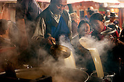Pilgrims pour steaming butter tea at a small Buddhist monastery near the Jokhang, in Lhasa, Tibet. (From the book What I Eat: Around the World in 80 Diets.)
