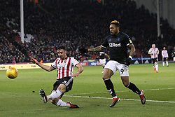 February 13, 2019 - Sheffield, South Yorkshire, United Kingdom - SHEFFIELD, UK 13TH FEBRUARY Enda Stevens of Sheffield United clears from Britt Assombalonga of Middlesbrough   during the Sky Bet Championship match between Sheffield United and Middlesbrough at Bramall Lane, Sheffield on Wednesday 13th February 2019. (Credit: Mark Fletcher | MI News) (Credit Image: © Mi News/NurPhoto via ZUMA Press)