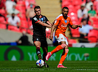 Lincoln City's Regan Poole vies for possession with Blackpool's Keshi Anderson<br /> <br /> Photographer Andrew Vaughan/CameraSport<br /> <br /> The EFL Sky Bet League One Play-Off Final - Blackpool v Lincoln City - Sunday 30th May 2021 - Wembley Stadium - London<br /> <br /> World Copyright © 2021 CameraSport. All rights reserved. 43 Linden Ave. Countesthorpe. Leicester. England. LE8 5PG - Tel: +44 (0) 116 277 4147 - admin@camerasport.com - www.camerasport.com
