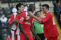 Photo: Pete Lorence.<br />Notts County v Swindon Town. Coca Cola League 2. 23/09/2006.<br />Fola Onibuje is congratulated after scoring the opening goal of the match.