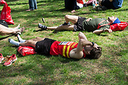 Competitors in the 2014 London Marathon. Exhausted runner at the finnish area. London, UK.