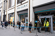 Shoppers queue enter to Primark on Oxford Street as non-essential shops reopen and the national coronavirus lockdown three eases on 12th April 2021 in London, United Kingdom. Now that the roadmap for coming out of the national lockdown has been laid out, this is the first phase of the easing of restrictions, and large numbers of people are out in Londons retail district to go shopping.