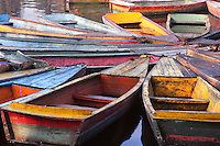 Colored boats in a ballet on the lake of Kunming, China.