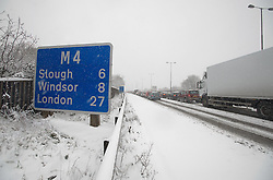 © under license to London News Pictures.  18/12/2010. Traffic battles through heavy snow along the M4 near junction 8 for Maidenhead, Berkshire today (18/12/2010).  Severe weather is expected to hit the whole of the UK this weekend. Photo credit should read Sam Long/ London News Pictures