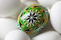 Closeup of Ukraine Easter egg, nestled in bowl of white eggs, Kodiak Island, Alaska.