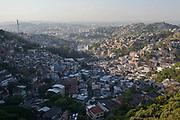 View of the urban sprawl of Rio Comprido and Prazeres favlea at dusk, Rio de Janeiro