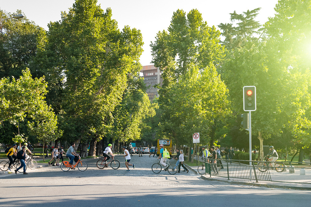 Santiago, Region Metropolitana, Chile - People riding bicycle in the Forestal Park, the more traditional urban park in the city.