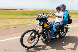 Danell and Stacy McCleary ride back to Sturgis after the annual Michael Lichter - Sugar Bear Ride hosted by Jay Allen with the Easyriders Saloon during the Sturgis Black Hills Motorcycle Rally. SD, USA. Sunday, August 3, 2014. Photography ©2014 Michael Lichter.