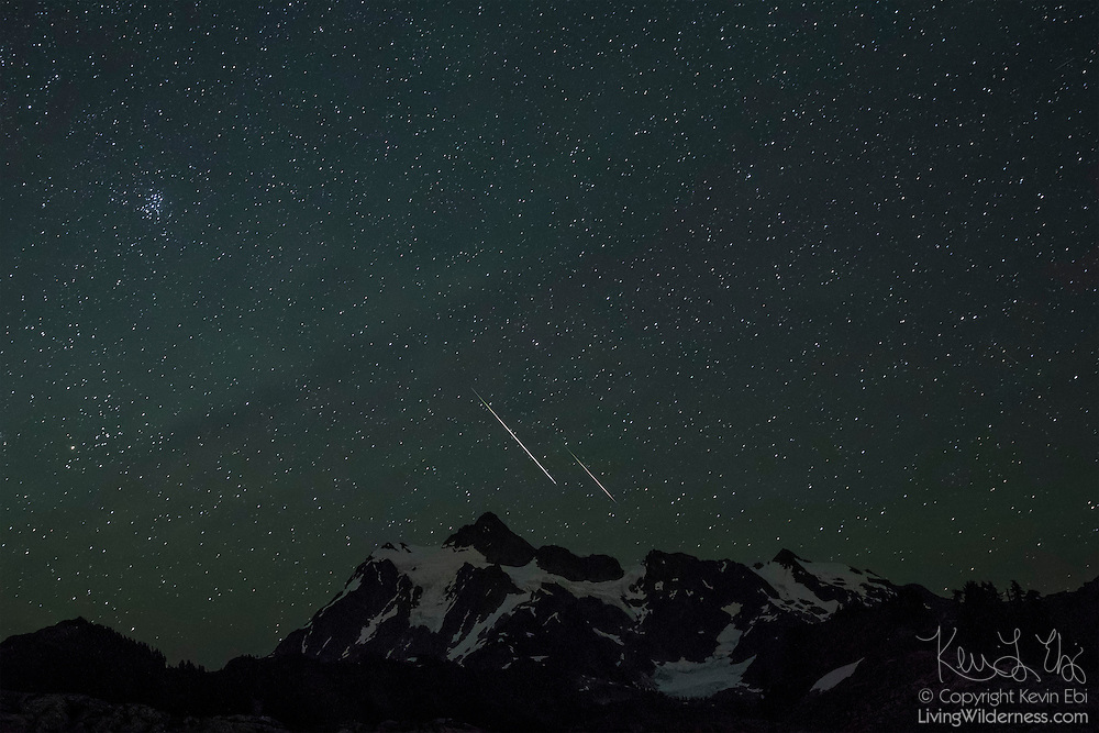 Several Perseid meteors, including two especially bright ones, streak across the sky over Mount Shuksan in the North Cascades of Washington state. The Perseids are an annual meteor shower that occurs in August when Earth passes through the debris of Comet 109P/Swift-Tuttle. The meteors are comet debris burning up in the Earth's atmosphere.