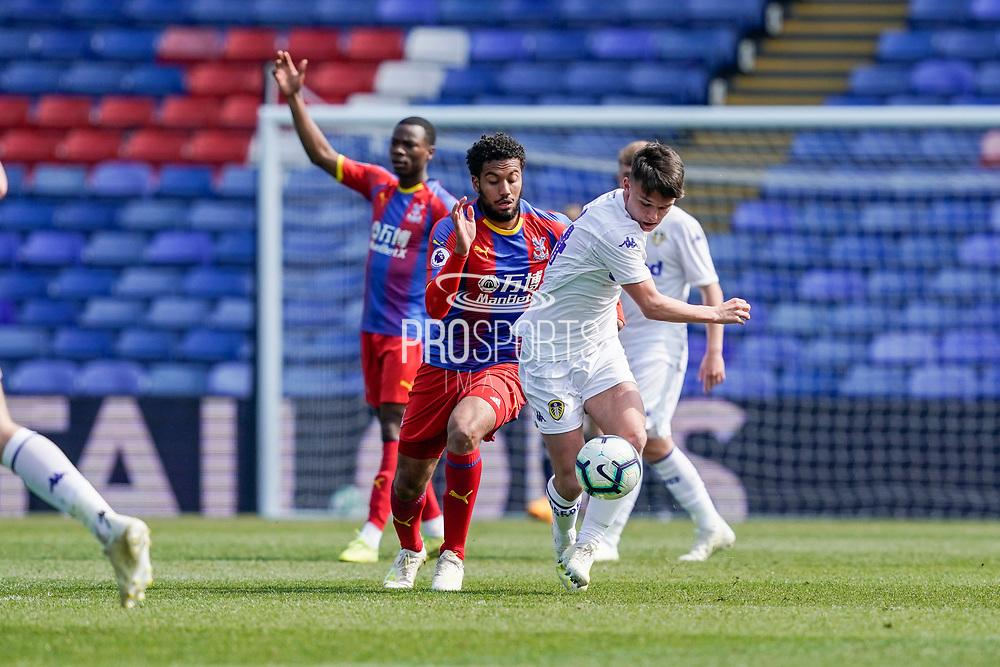 Jamie Shackleton of Leeds U23 under pressure during the U23 Professional Development League match between U23 Crystal Palace and Leeds United at Selhurst Park, London, England on 15 April 2019.