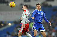Barnsley's Josh Scowen (l) beats Cardiff City's Craig Noone to a header. EFL Skybet championship match, Cardiff city v Barnsley at the Cardiff city stadium in Cardiff, South Wales on Saturday 17th December 2016.<br /> pic by Carl Robertson, Andrew Orchard sports photography.