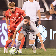 MEADOWLANDS, NEW JERSEY- August 7: Maxime Gonalons #21 of AS Roma challenged by Martin Odegaard #36 of Real Madrid in during the Real Madrid vs AS Roma International Champions Cup match at MetLife Stadium on August 7, 2018 in Meadowlands, New Jersey. (Photo by Tim Clayton/Corbis via Getty Images)