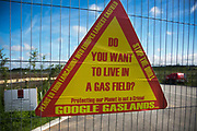 A sign put up by anti-fracking activists near the entrance to  Quadrillas drill site in New Preston Road, July 01 2017, Lancashire, United Kingdom. Do you want to live in a gas field.. The sign is part of a blockade as a repsonse to the emmidiate drilling for shale gas, fracking, by the fracking company Quadrilla and part of an ongoing struggle where makeshift towers and makeshift camps have sprung up outside the premisses. Lancashire voted against permitting fracking but was over ruled by the conservative central Government. Fracking is a highly contested way of extracting gas, it is risky to extract and damaging to the environment and is banned in parts of Europe . Lancashire has in the past experienced earth quakes blamed on fracking.