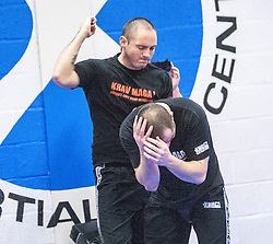 Stef Noij, KMG Instructor from the Institute Krav Maga Netherlands, punches during the IKMS G Level Programme seminar today at the Scottish Martial Arts Centre, Alloa.