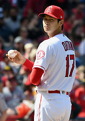 April 8, 2018 - Anaheim, CA, U.S. - ANAHEIM, CA - APRIL 08: Los Angeles Angels of Anaheim pitcher Shohei Ohtani (17) looks over at first base after giving up a hit the seventh inning of a game against the Oakland Athletics played on April 8, 2018 at Angel Stadium of Anaheim in Anaheim, CA (Photo by John Cordes/Icon Sportswire) (Credit Image: © John Cordes/Icon SMI via ZUMA Press)