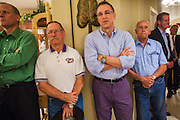 "03 AUGUST 2012 - GILBERT, AZ: MATT SALMON (center) stands with Republican voters during a campaign ""meet & greet"" in Gilbert, AZ, Friday night. Salmon is running in the Republican primary for Arizona's 5th Congressional District. Salmon previously served in Congress from 1994 until 2000. CD5 is a primarily Republican district, with a large number of conservative Mormons, in the suburbs east of Phoenix. Salmon is running against Kirk Adams, a former Speaker of the Arizona House of Representatives. Whoever wins the August 28 Republican primary will probably win in November's general election.   PHOTO BY JACK KURTZ"