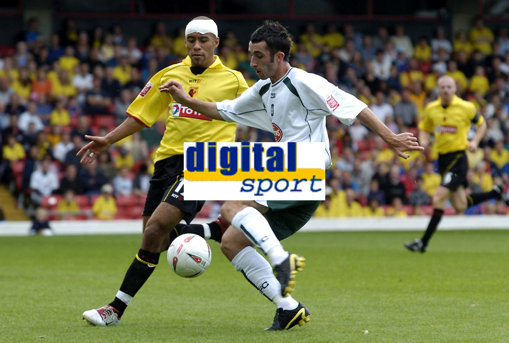 Fotball<br /> Foto: SBI/Digitalsport<br /> NORWAY ONLY<br /> <br /> Watford v Plymouth Argyle<br /> Coca-Cola Championship. 28/08/2004.<br /> <br /> Tony Capaldi crosses the ball as James Chambers challenges.