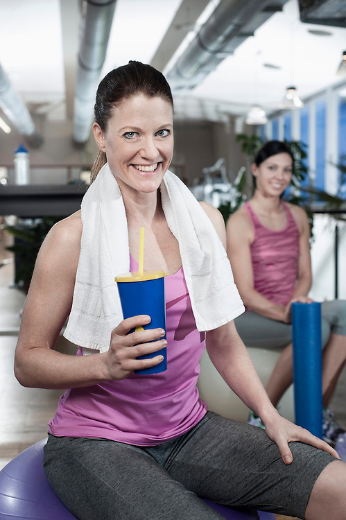Portrait of smiling woman in a gym